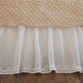 "With embroidered floral and polka-dot details, this delicate bed skirt offers ethereal country style for your guest bedroom or master suite.   Product: Bed skirtConstruction Material: Linen and organdyColor: CreamFeatures: Intricate embroideryDimensions: 18"" DropCleaning and Care: Dry clean only"