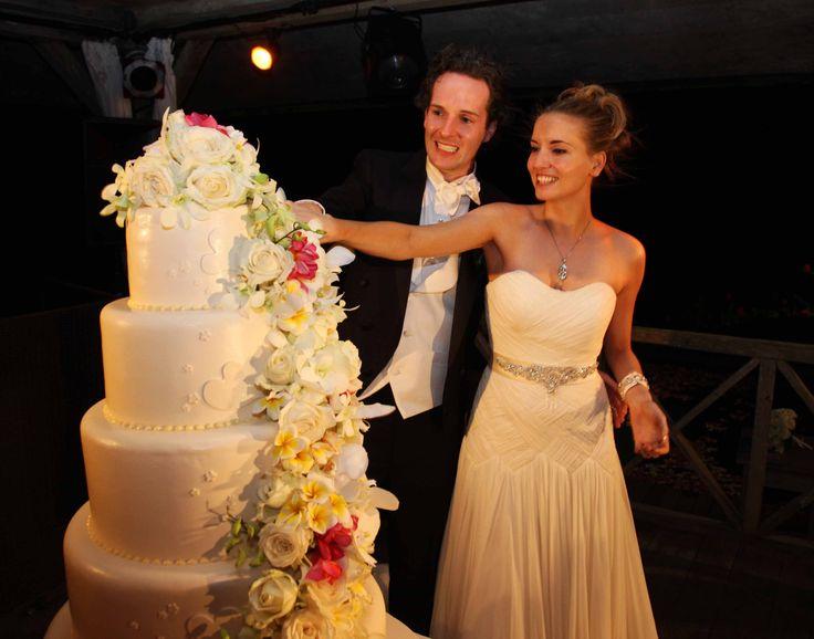 Weddings   The lovely Kelly & Nik cut the elegant tiered cake adorned with romantic flowers. Khayangan Estate, Bali. @Ixoracakes