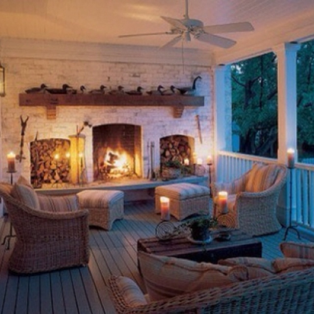 Love the color palette here...very cool, subdued tones with the warmth of the fireplace cozying-up the space!