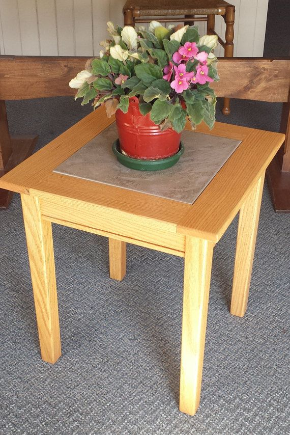 "This versatile oak table can be used in a variety of situations. The table is made from solid oak, built to hold the nice 12"" tile. Please"
