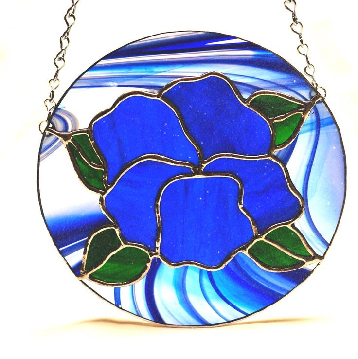 A personal favorite from my Etsy shop https://www.etsy.com/listing/565129226/cobalt-blue-hibiscus-stained-glass