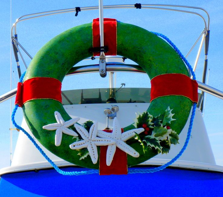 A life ring on the boat becomes  a Christmas wreath.
