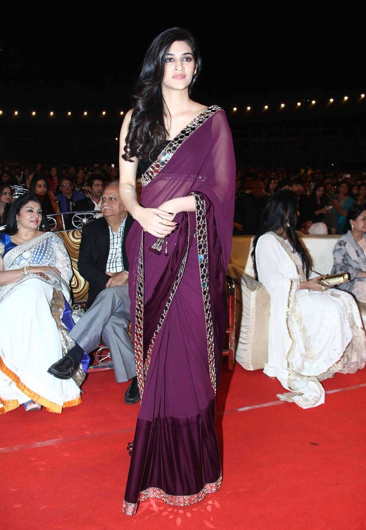Bollywood Actress Kriti Sanon Georgette and Net saree in purple colour