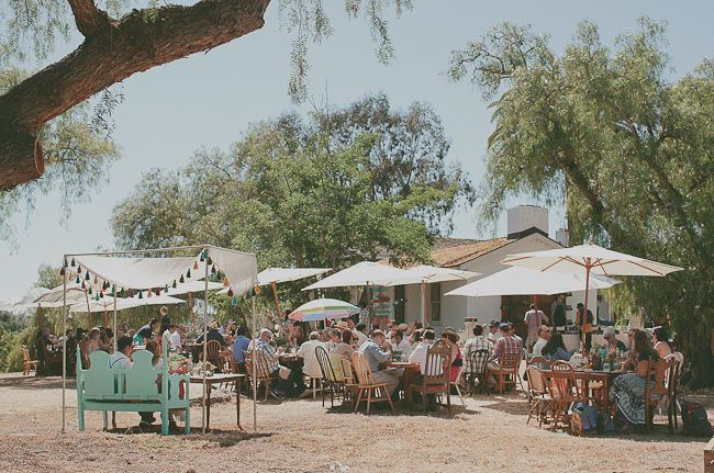 eclectic outdoor dining area, i even think the umbrellas could be brought indoors!  create a wonderful feel!