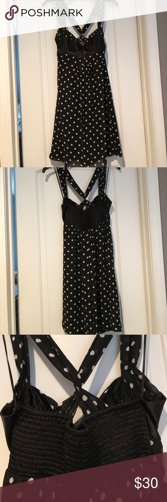 Polka dot cocktail dress This is a super cute black and white polka dot dress. Straps and lower part of dress are chiffon and bust is satin. Back of straps twist and there is shirring on back. Liner under skirt. Excellent condition and has a fun retro look to it!  Size tag says 7, but I would say it fits size small best. Guess Dresses