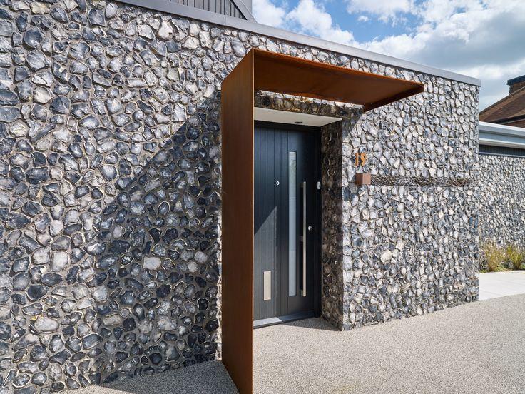 An Urban Front door with beautifully detailed Corten Door Canopy.