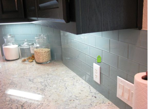 Tighter grout joints and using a grout color that is closer to the color of the tile will give us this look which i prefer.  Your installer would need to set the tile using 1/16th inch spacers and then grout with unsanded grout. He can recess the grout using the grout tool to minimize the effect of the grout. He will also need to draft and score the tile with a carbide cutting wheel or tool to get the waves in the glass. All of this will be more time and labor. I would ask your installer of…