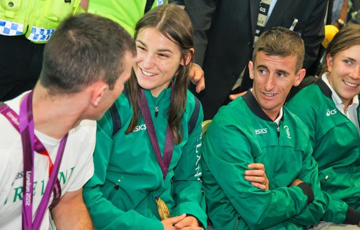 John Joe Nevin and Katie Taylor share a joke as Robert Heffernan and Annalise Murphy look on #TeamIreland #Olympics #London2012 #Ireland #Dublin #DublinAirport