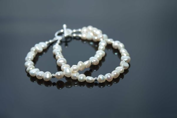 Luna Twin Strand Bracelet, classic informal bracelet of white nugget pearls and silver balls.
