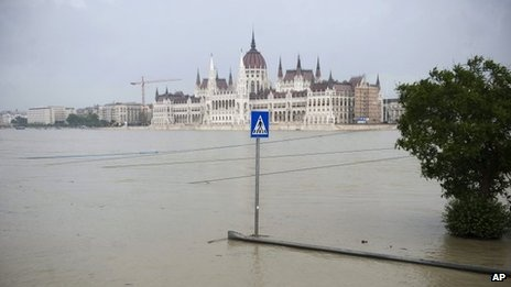 """Hungarians have been warned to prepare for their country's worst floods ever as the Danube is set to reach record levels this weekend.  """"We are facing the worst floods of all time,"""" said PM Viktor Orban.  Europe's second longest river is set to hit unprecedented levels in the capital Budapest in the next few days.  A state of emergency has been declared, and thousands of volunteers worked overnight to reinforce the banks of the swelling river."""