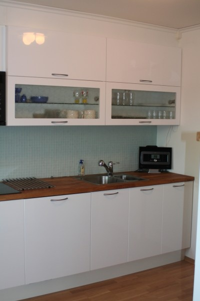 Ikea abstrakt with glass wall cabinets