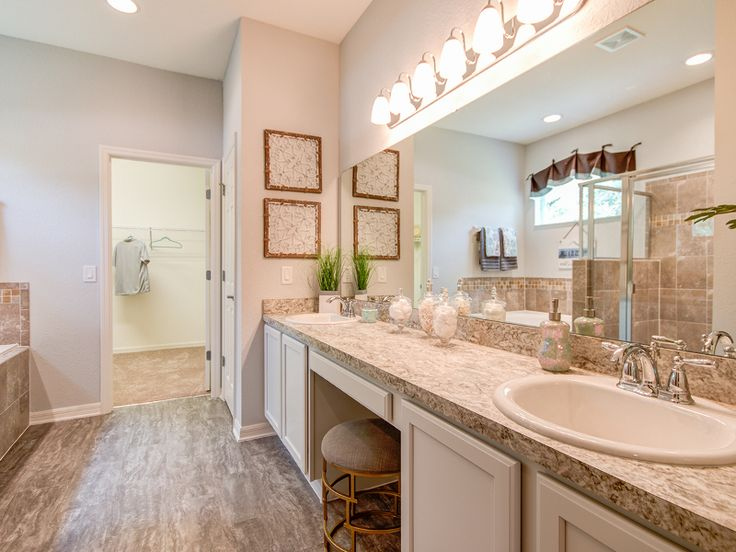 Pics On Why go to the spa when your personal bathroom looks like this one This luxurious master bathroom featured decorative wall tile with glass accents in the