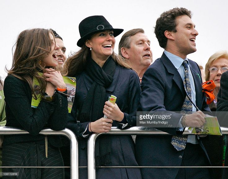 Kate Middleton and Thomas van Straubenzee cheer as they watch the Gold Cup horse race on day 4 of the Cheltenham Horse Racing Festival on March 14, 2008 in Cheltenham, England.