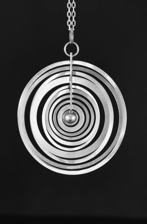 """Full Moon"" silver necklace by Tapio Wirkkala 1973 Finland // Consisting of nine kinetic hand made circles in sterling silver. A Finnish jewelry masterpiece. // Just Brilliant! // http://www.nordlingsantik.com/jewellery/full-moon-necklace-by-tapio-wirkkala"
