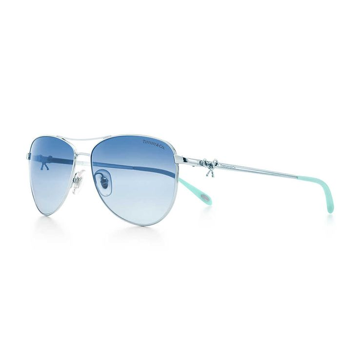 My dream sunglasses...unashamed to taking donations! LOL Tiffany Twist aviator bow sunglasses in silver-colored metal.
