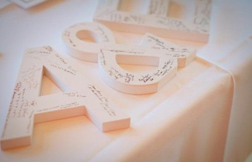 Super cute #guestbook alternative using oversized wooden letters of the bride and groom's first names!
