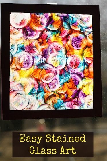 """""""Stained Glass"""" painting with a bottle lid and wax paper - happy hooligans"""
