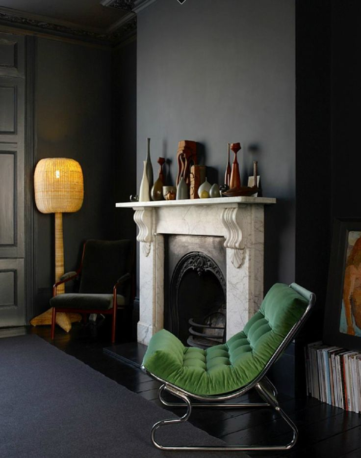 Interior Design. Black walls, white marble fireplace, yellow lamp, green tufted chair. East London Victorian Home.
