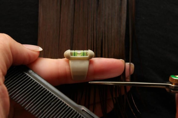 Haircutting level for cosmetology students to help them get used to holding their fingers straight while cutting. www.HatalaLevel.com