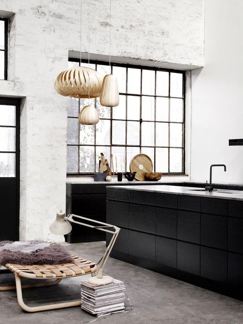 concrete floors, white brick walls & dark kitchen. Love the steel windows