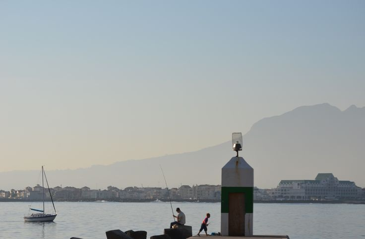 Angling on the pier at Gordons Bay harbour. Harbour Island on the horison with Helderberg mountain as backdrop. #angling #GordonsBay #harbour #pier