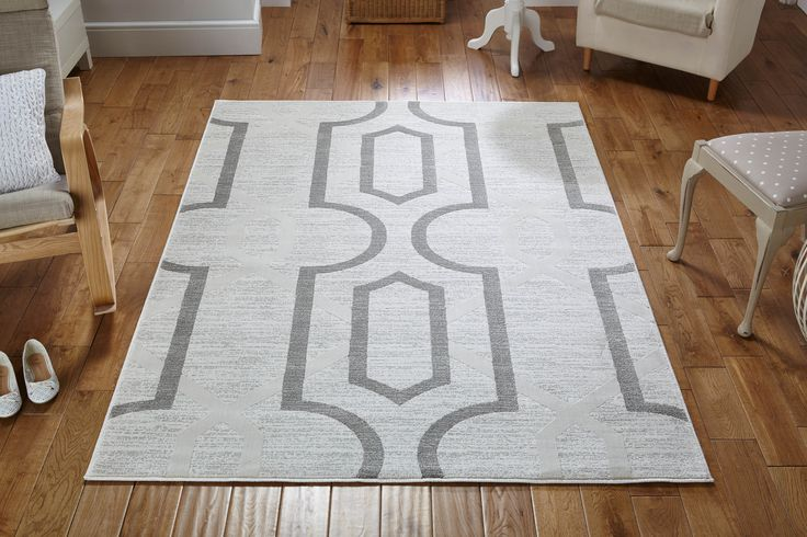 This amazing Louvre Rug comes with a strong style statement. Give your room a cheeky look.  #modernrugs #durablerugs #designerrugs #abstractrugs #geometricrugs