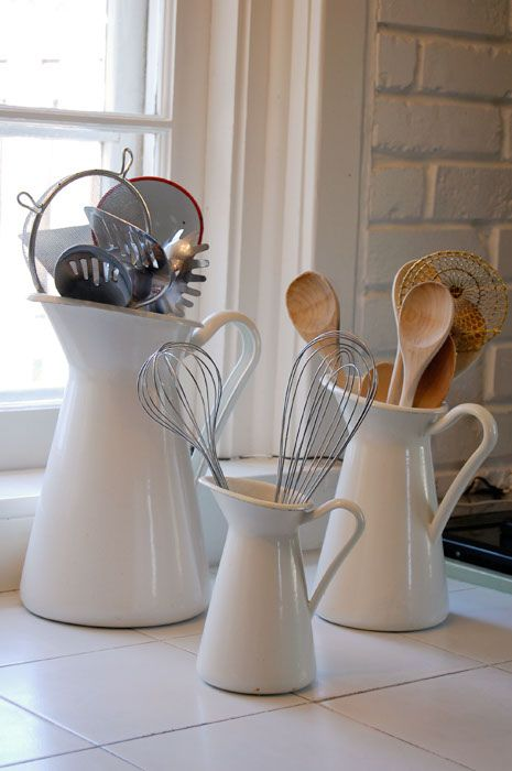 Simple Storage Solutions: Alternatively, utensils could go in decorative containers on the counter to make more drawer-space. Still, I'd rather keep clutter off the counters if possible. Maybe hang the pitcher