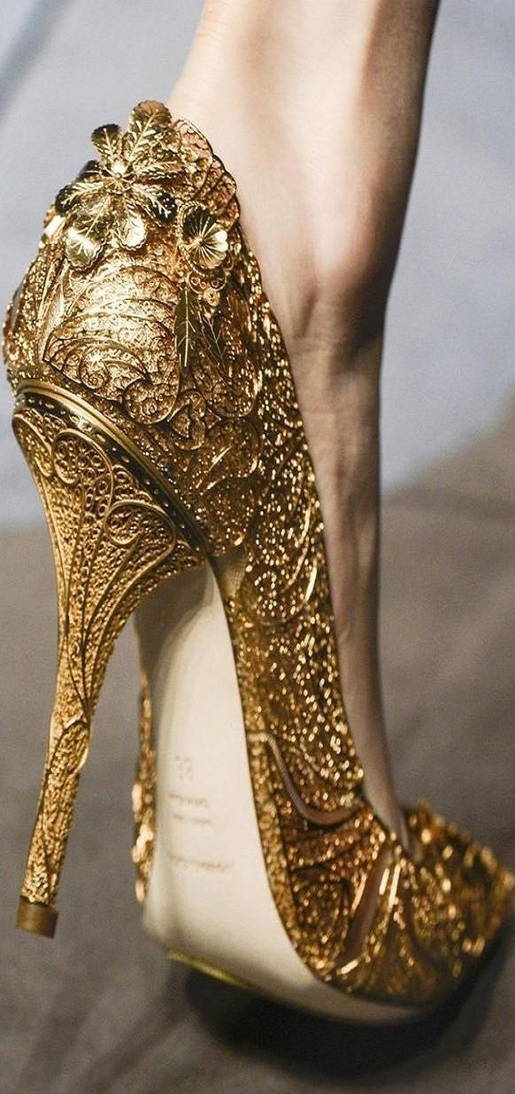During bridal shower or bachelorette party have all the girls bring a pair of heels or flats and everyone glue on beads and make patterns with fabric paint, then spray paint them all gold