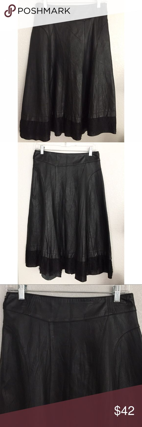 "Black Leather Midi Skirt with Lace Hem Black Leather Midi Skirt with a slightly asymmetrical cut. It has a Lace Hem over more raw cut leather. Very unique piece. Zips up on the side. 27.5"" long. Made in Korea. Skirts Midi"