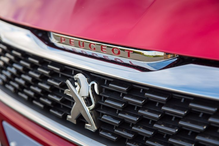 The 308 GTi by Peugeot Sport has classic sports car features abound including checkerboard radiator grille.