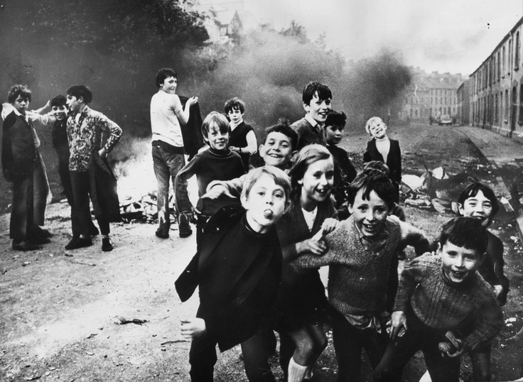 Children jeer at British soldiers while a fire smoulders in the street behind them. (Photo by Keystone/Getty Images). 7th December 1971