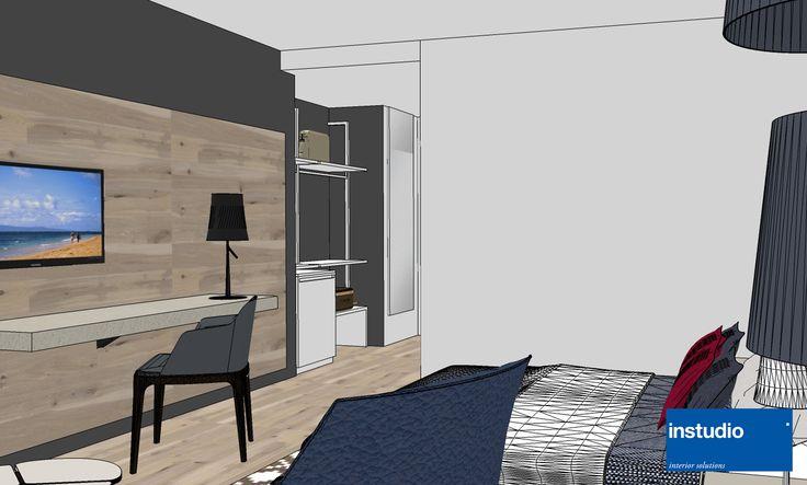 Area scrittoio lineare e funzionale è delimitata da un rivestimento in legno. #hoteldesign #interiordesign