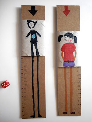 Cardboard game:  We have cut a piece of cardboard with a width enough to fit a squeezed paper roll. On the paper roll we have paint us without legs. We have drawn our legs and feet in the cupboard also with a numbered rule. With a dice numbers you let your legs grow. The tallest person win!