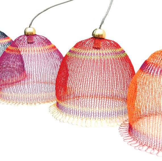 Knitted wire lampshades on Etsy.  Also, several patterns for knitting/crocheting your own wire stuff.
