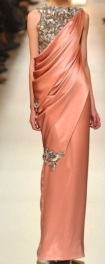 Peachy coral satin.. Has the look of an Indian saree