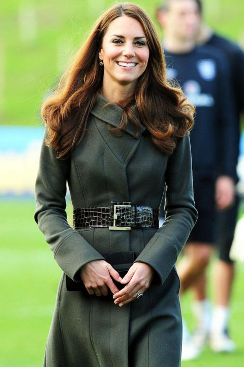 The Duchess attends the launch of the Football Association's National Football Centre in Burton in Trent, England, wearing an olive green Reiss coat.