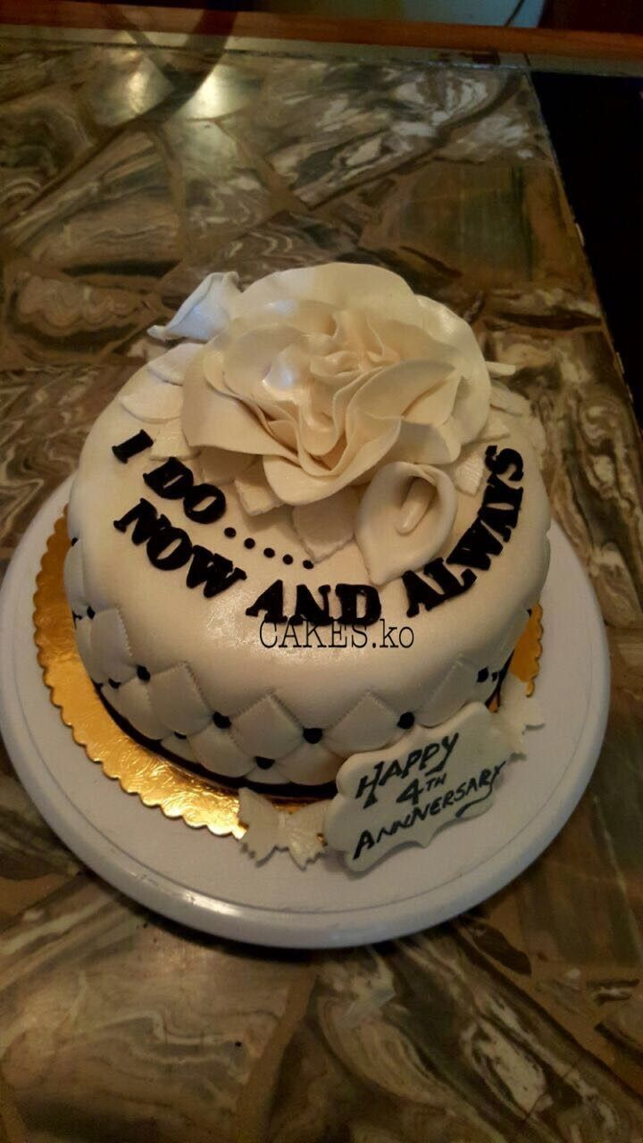 Simple elegant Black and white Anniversary cake.  Click link to my business page for more of my work.