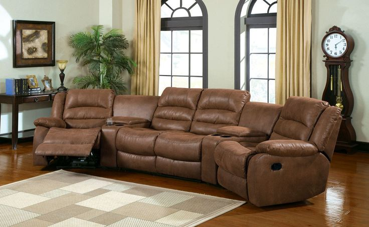 MANCHESTER This transitional, plush seating group features built in recliners and consoles with drink holders. Upholstered in a caramel leather-like fabric. Sale for $1070