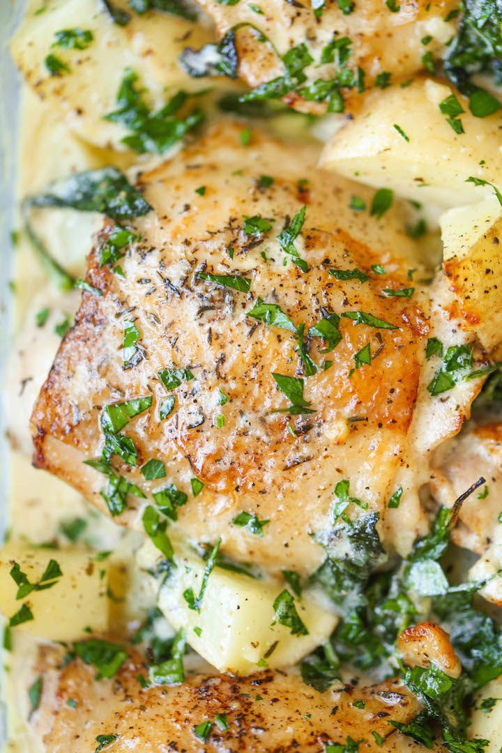 Chicken and Potatoes with Garlic Parmesan Cream Sauce - Crisp-tender chicken baked to absolute perfection with potatoes and spinach. A complete meal in one!