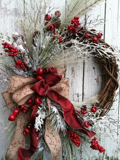 Christmas Country Wreath - Winter Red and White Wreath - Country Wreath for Door This wreath is designed on a grapevine base with snow flocked branches, pine, and red berries. It is all complimented with a natural bow with a berry print. This wreath is approximately 26 from top to bottom and 20 across to the farthest tips. The grapevine wreath base is roughly 18 across. *Please note, each wreath is made to order, there may be some very slight variations to each wreath because they are one…
