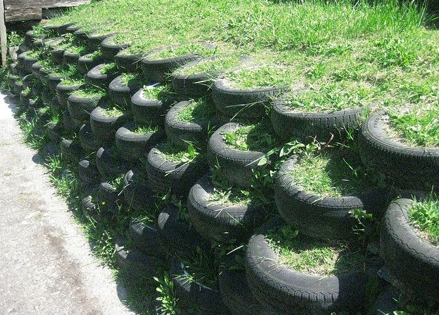 Tire retaining wall. All it needs is some plants and it would look super