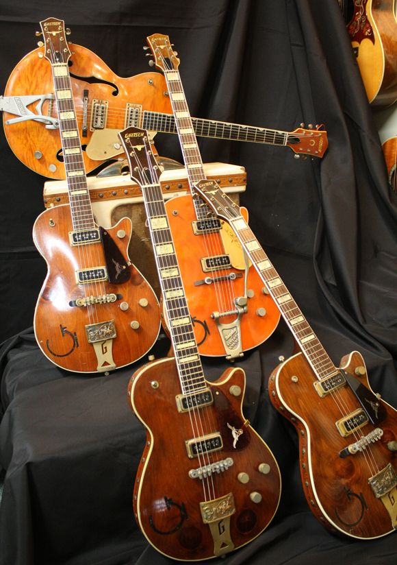 The three Gretsch 6130 Roundups in this photo are from 1954. The orange Gretsch 6121, also from '54, was actually a little pricier despite its simpler Bigsby tailpiece. The amp is a 1956 Electromatic with the side panel control input with a 15-inch speaker. The Gretsch 6120 atop the amp is from '59.