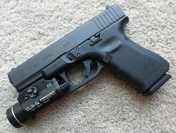 glock 19 gen 4 with a streamlight tactical light weapons