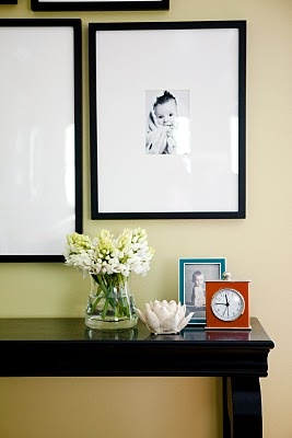 framed black and whites over console table