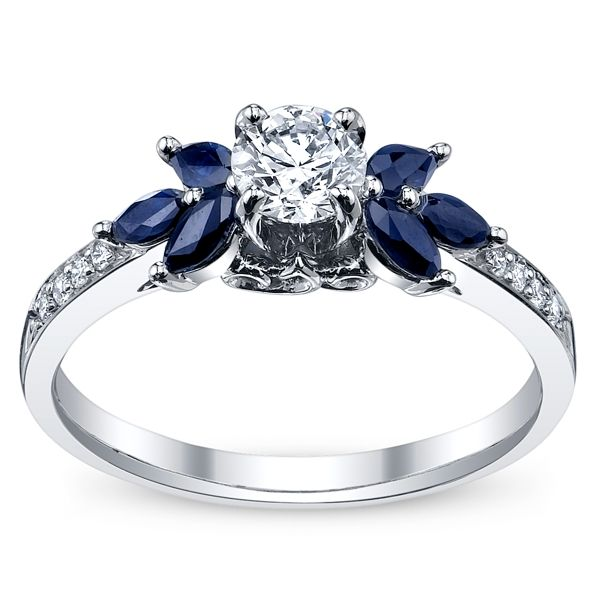 Something like this with diamonds instead of sapphires and an emerald cut center stone.