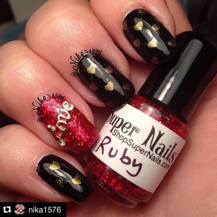 #Repost @nika1576 with @repostapp.  Playing catch up with my #nailchallenge here is my #notd for day 14 of #firedazedfeb theme V-Day and #clairestelle8feb theme Love ...I used this beautiful red glitter called #ruby by @kseagale #supernailslacquer #iminluv #nailart #nailswag #nailsofig #nailpolish #wetnwild #ebonyhateschris #dailyhues #jenn  the most beautiful holo gold. by fire.dazed.challenge