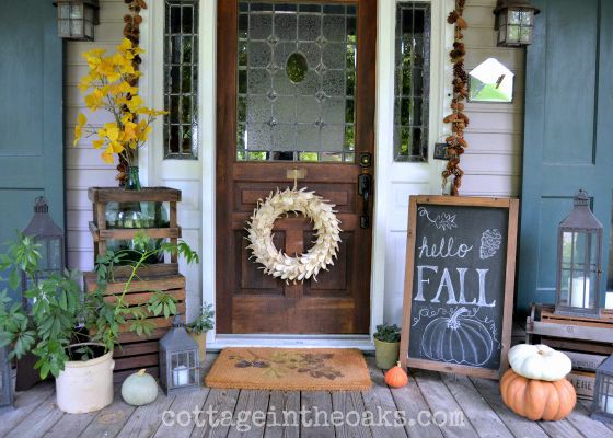 This porch is cute, of course, but thanks to its chalkboard sign (which can be updated for Halloween or Thanksgiving) its decorations are also versatile throughout the season.   See more at Cottage in the Oaks.