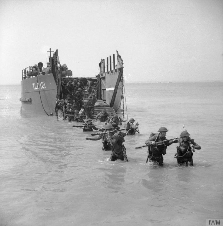 Troops wade ashore from a tank landing craft during a combined operations exercise at Thorness Bay on the Isle of Wight, 27th May 1942