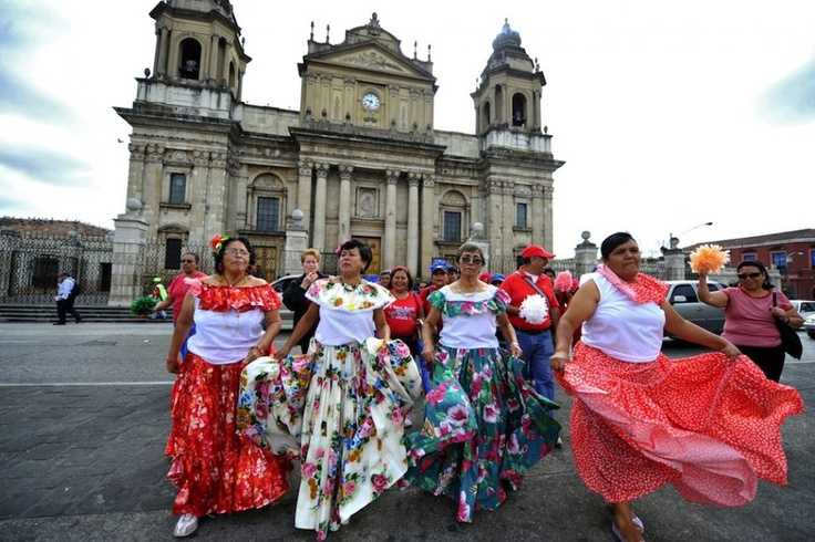 Elderly women dance during the Old Love Parade, held as part of the celebrations of Valentine's Day, at Constitution Square in Guatemala City's historic center. (Johan Ordonez - AFP/Getty Images)