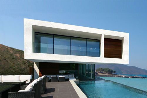 """The WOLF Contemporary Beach house has a design that stands up to the best beach side homes on an International scale. The house has presence without impinging upon the beautiful context. To have a home that resonated an """"understated elegance"""" was what the client's stated in their brief.  PROJECT INFO"""